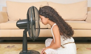 a girl and electric fan